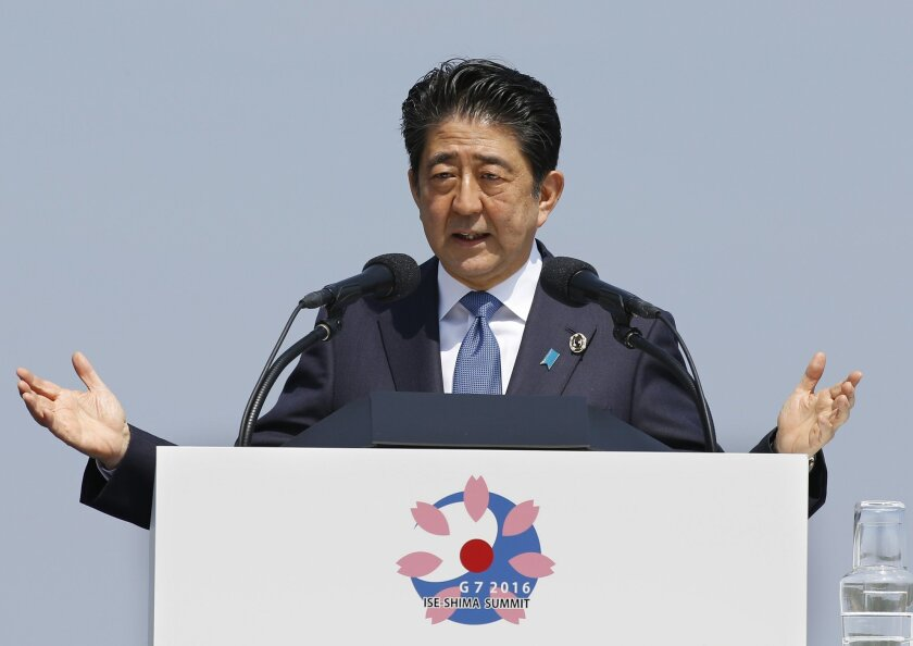 FILE - In this May 27, 2016, file photo, Japanese Prime Minister Shinzo Abe speaks at a press conference at the G-7 summit in Shima, central Japan. For months, Abe said he would go ahead with a planned sales tax next year, even as rumors swirled that he was having second thoughts as a parliamentary