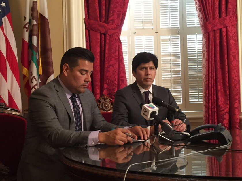 Sen. Ricardo Lara (D-Bell Gardens), left) and Senate President Pro Tem Kevin De Leon (D-Los Angeles) speak at a news conference touting the benefits to immigrants in the budget deal announced Tuesday.