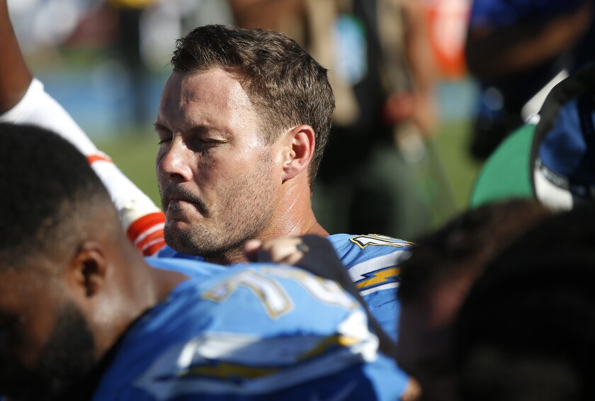Philip Rivers prays after a loss to the Broncos in Carson on Oct. 6.