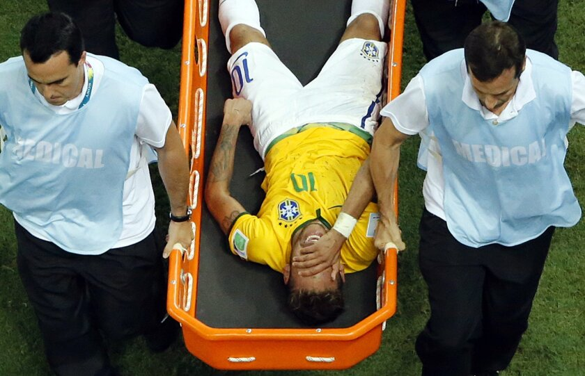 Brazil's Neymar is carried away on a stretcher during the World Cup quarterfinal soccer match between Brazil and Colombia at the Arena Castelao in Fortaleza, Brazil, Friday, July 4, 2014. (AP Photo/Fabrizio Bensch, pool)