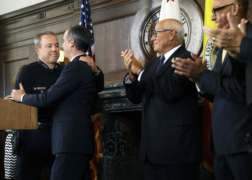 Los Angeles Mayor Eric Garcetti announces LAPD Assistant Chief Michel Moore, left, as his choice to succeed Police Chief Charlie Beck, whose last day is June 27. Moore bested dozens of candidates for the position, including two other finalists with experience at the department.