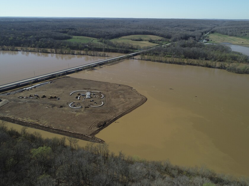 This photo taken on March 29, 2001, shows a light-colored plume extending from a controversial sand and gravel mine on the Duck River in Tennessee. Volunteer Sand and Gravel has been ignoring a cease and desist letter for months, and opponents say its continued construction on the banks of North America's most biodiverse river may already be harming wildlife. ( Matt Reed/BDY via AP)