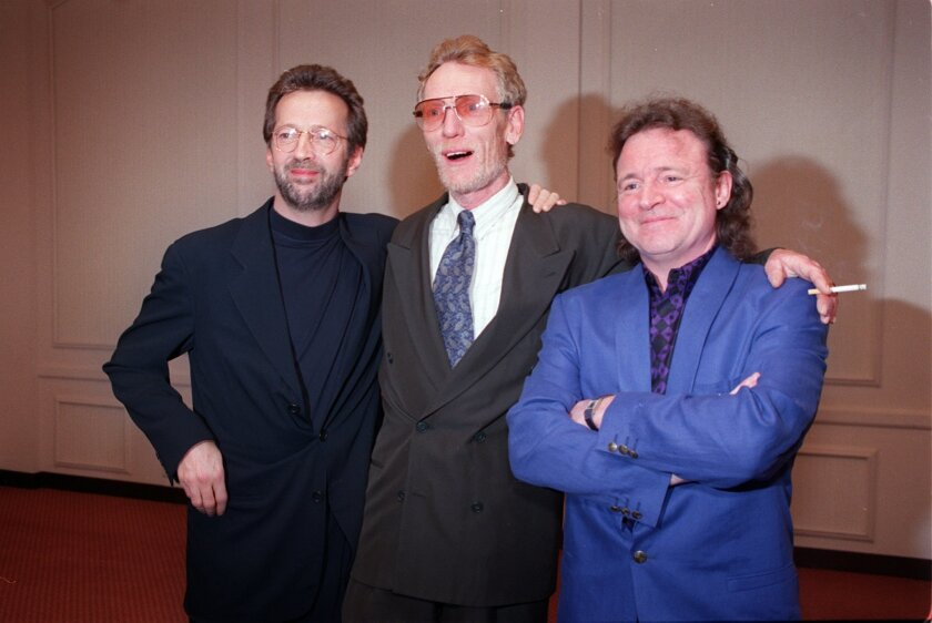 In this 1993 file photo, Eric Clapton, left, Ginger Baker, center, and Jack Bruce pose prior to Cream's Rock & Roll Hall of Fame induction ceremony  in Los Angeles.