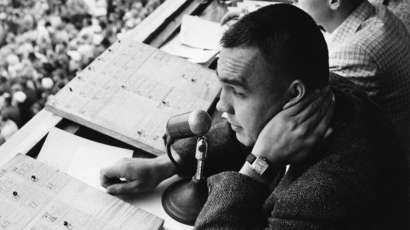 Dick Enberg works as the voice of Indiana University athletics during a Hoosiers football game in the late-1950s.