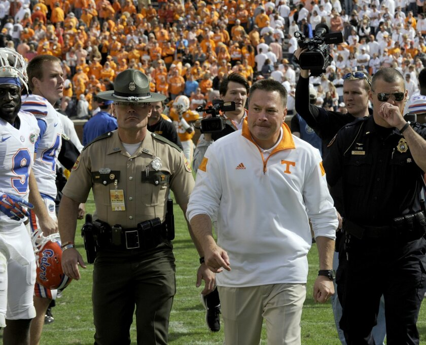 Tennessee coach Butch Jones walks off the field following their 10-9 loss to Florida in an NCAA college football game at Neyland Stadium, Saturday, Oct. 4, 2014, in Knoxville, Tenn. (AP Photo/Knoxville News Sentinel, Michael Patrick)