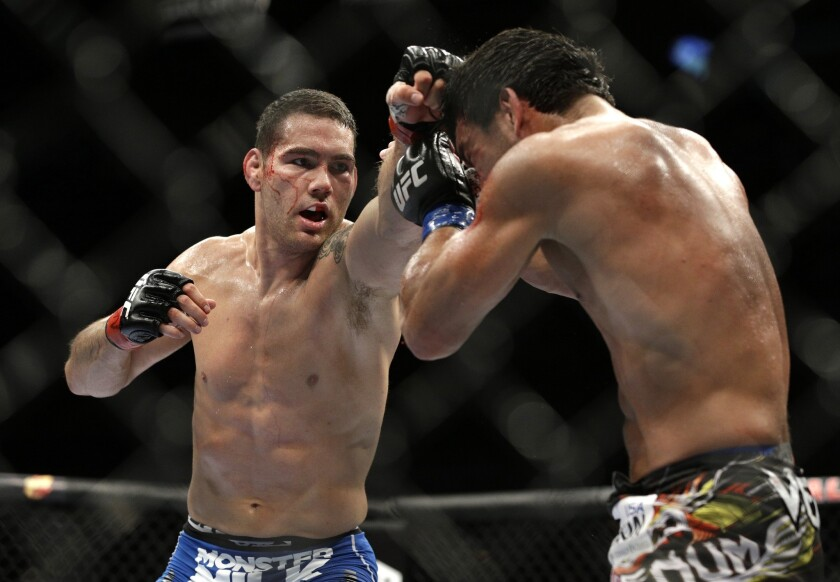 Chris Weidman, left, improved to 12-0 when he defeated Lyoto Machida by unanimous decision in a middleweight title bout July 5.