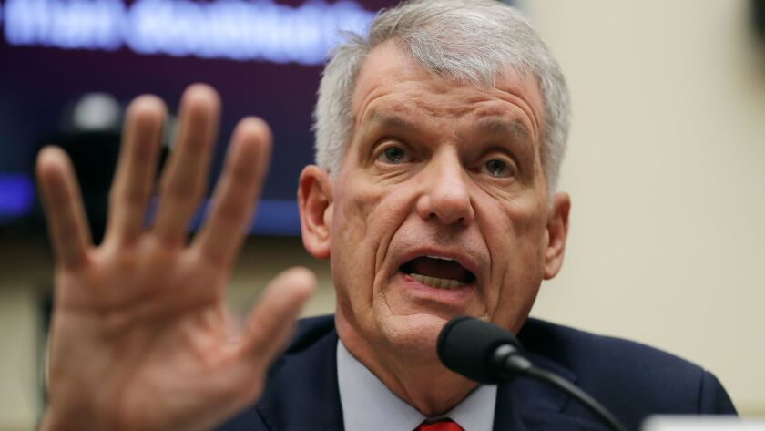 Tim Sloan, chief executive of Wells Fargo & Co., testifies before the House Financial Services Committee in Washington on Tuesday.