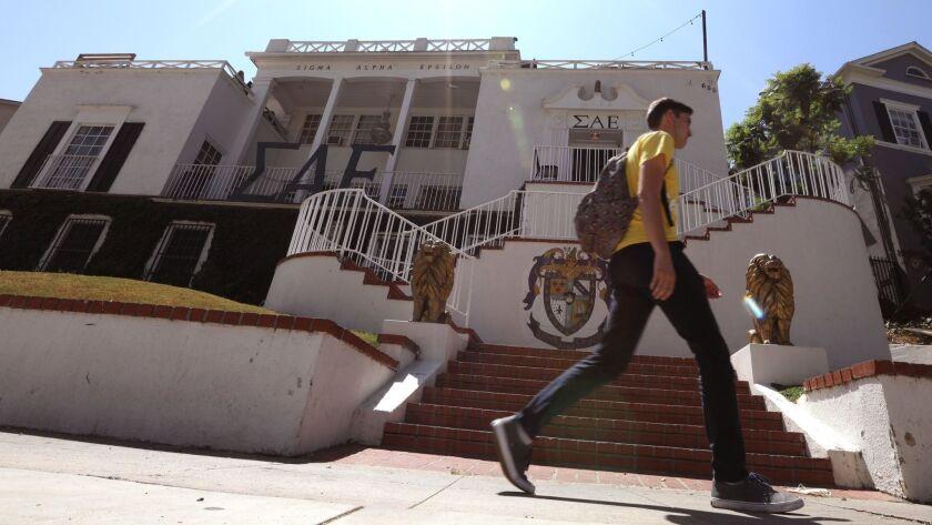 LOS ANGELES, CA - AUGUST 31, 2018 - A pedestrian walks past the Sigma Alpha Epsilon fraternity house
