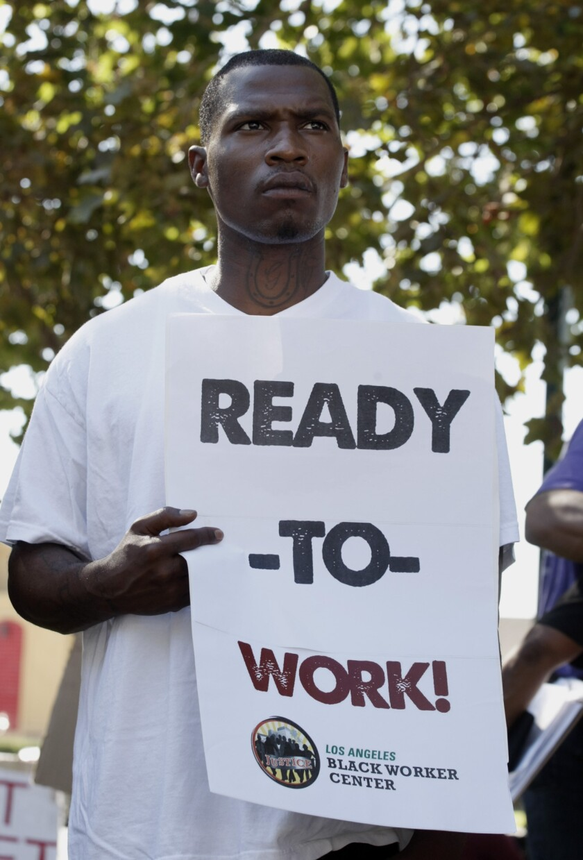"""Arthur Gosey participates in a """"ready to work"""" rally held by the Los Angeles Black Worker Center last year at Leimert Park. A new report released Thursday pointed out that blacks were falling behind whites and Latinos when it came to employment and income."""