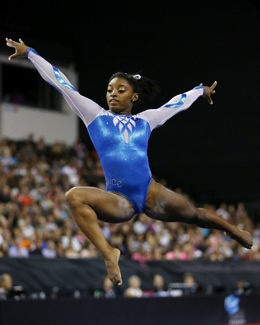 Simone Biles competes in the floor exercise during the Secret U.S. Classic gymnastics event Saturday, July 25, 2015, in Hoffman Estates, Ill. Biles finished first overall. (AP Photo/Andrew A. Nelles)