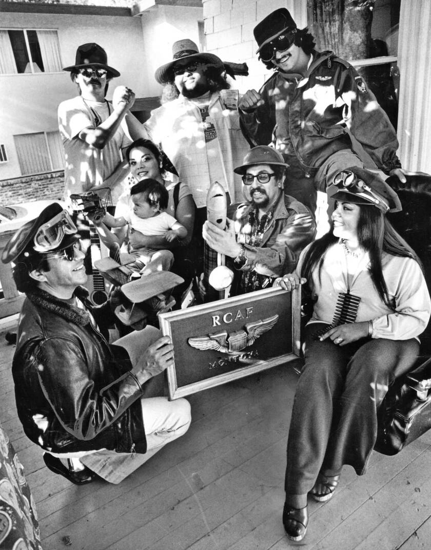 Jose Montoya synthesized his various roles and concerns – community organizer, Chicano-rights advocate, Central Valley bard – as a co-founder of the Rebel Chicano Art Front, the slyly subversive Sacramento art collective later re-christened the Royal Chicano Air Force. Above, Montoya, center, holds a toy launching bazooka amid fellow members of the Royal Chicano Air Force in 1979.