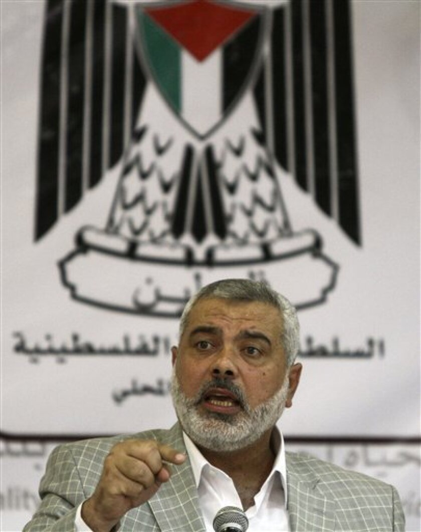Gaza Hamas Prime Minister Ismail Haniyeh speaks at a ceremony for the inauguration of a newly renovated street in Gaza City, Wednesday, July 14, 2010. A Libyan charity's aid ship, flanked by Israeli missile boats, was sailing in the direction of an Egyptian port on Wednesday, apparently deciding no