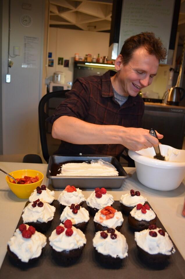Scientist Oleg Abramov frosts Dark Matter cupcakes inside a dome simulating a Martian base on Mauna Loa, Hawaii.