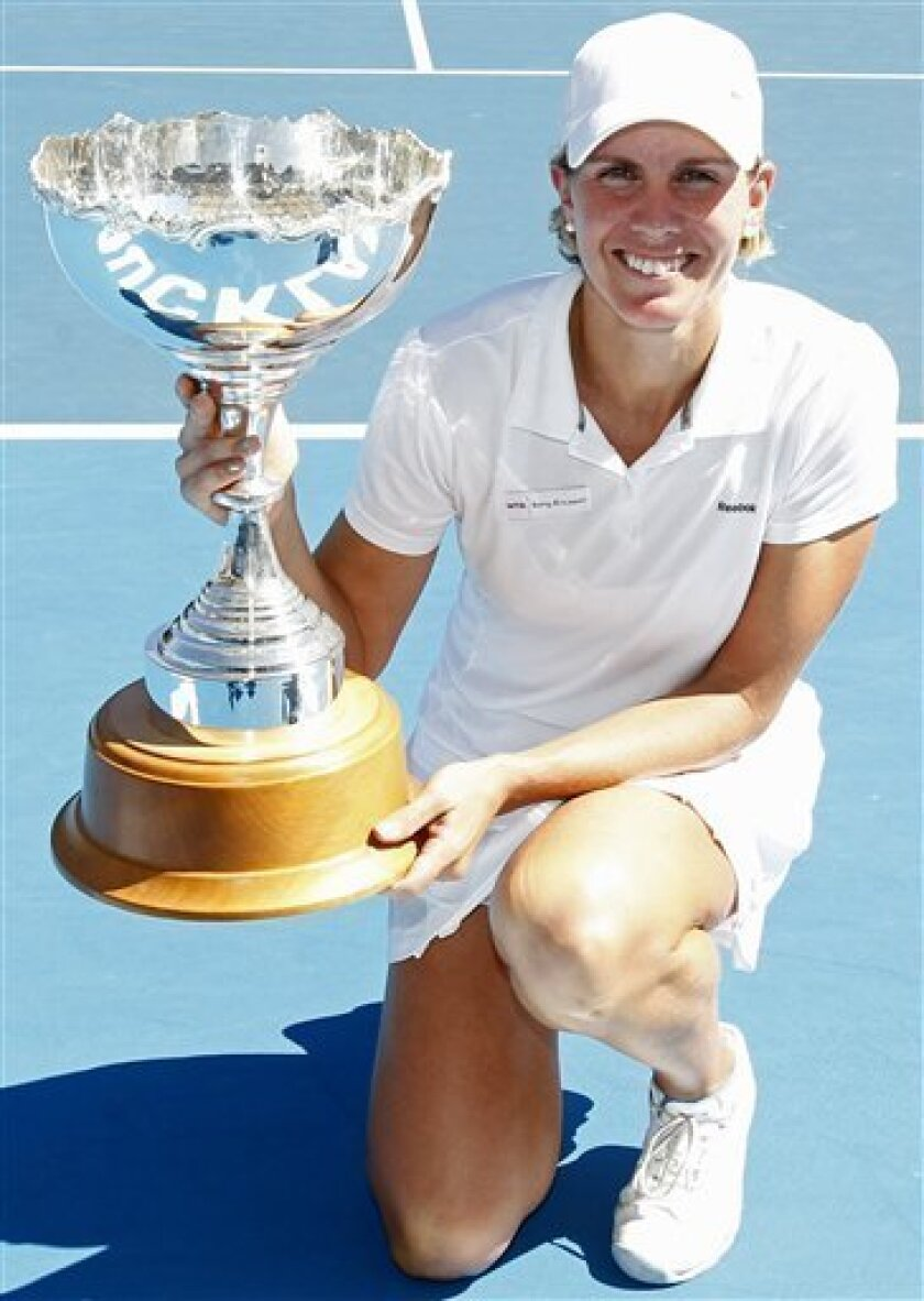 Greta Arn of Hungary holds the winner's trophy after her win against Yanina Wickmayer of Belgium in the final of the ASB Classic Women's Tennis Tournament at ASB Tennis Centre in Auckland, New Zealand, Saturday, Jan. 8, 2011. (AP Photo/NZPA, Wayne Drought)  NEW ZEALAND OUT