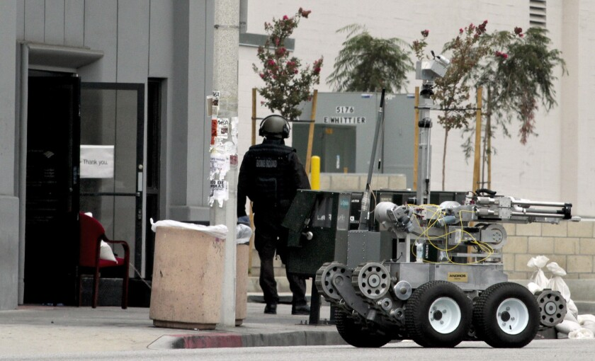 A robot and bomb squad were brought to the seen of a Bank of America where a robbery occurred in East Los Angeles on September 5, 2012. The leader of the heist was sentenced Monday to 14 years in prison.