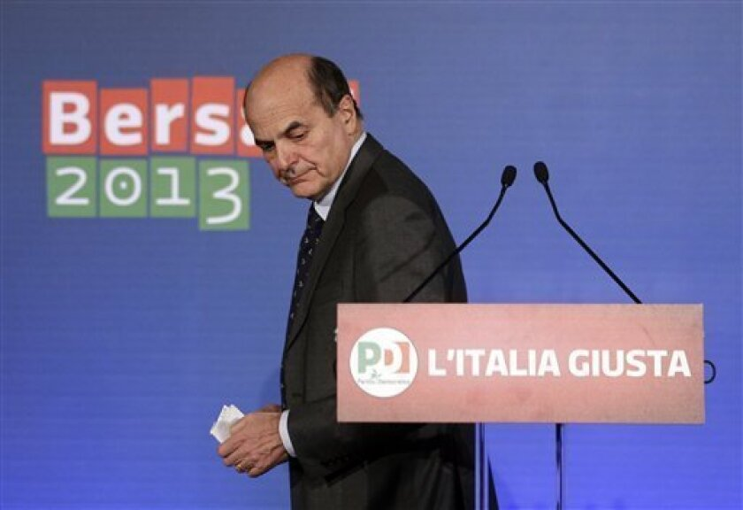 Democratic Party leader Pierluigi Bersani leaves after a press conference in Rome, Tuesday Feb. 26, 2013. Italy emerged from elections Tuesday with no clear winner, driving markets around the world markedly lower as investors worried that one of Europe's biggest economies would be unable to build a