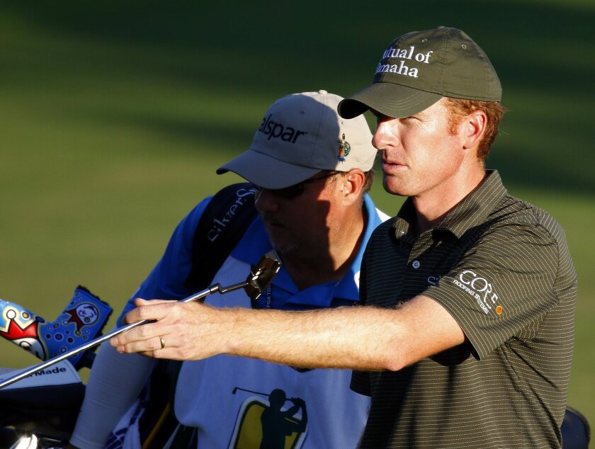 Roberto Castro directs, right, his caddie to his ball on the final hole in the first round of the Sanderson Farms Classic golf tournament in Jackson, Miss.,Thursday, Nov 5, 2015. (AP Photo/Rogelio V. Solis)