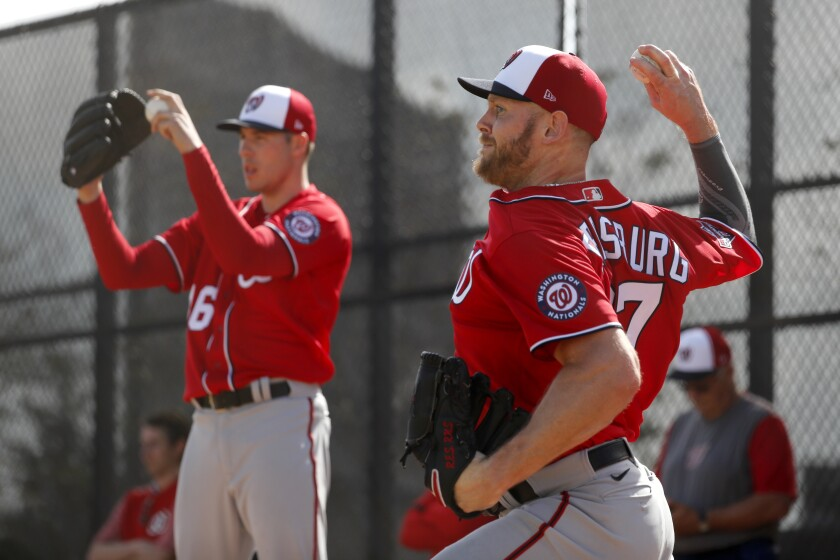 Washington Nationals pitchers Stephen Strasburg, right, and Patrick Corbin throw bullpen sessions during spring training baseball practice Friday, Feb. 14, 2020, in West Palm Beach, Fla.