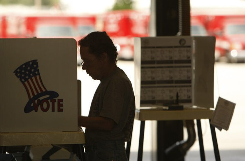 A voter casts a ballot in Los Angeles in an election earlier this year. An Assembly vote Tuesday resulted in a win for Democrat Matt Dababneh of Encino, according to a final canvass.