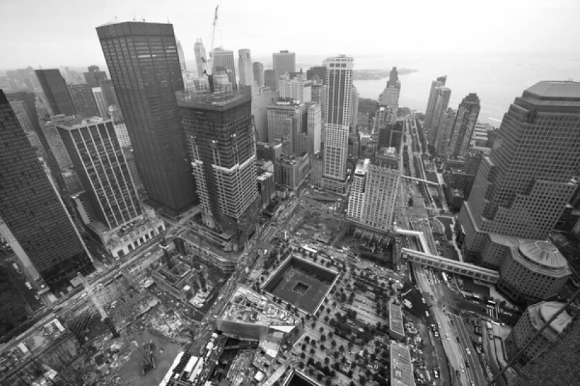 """The view from the unfinished Freedom Tower that rises above the """"Reflecting Absence"""" memorial."""
