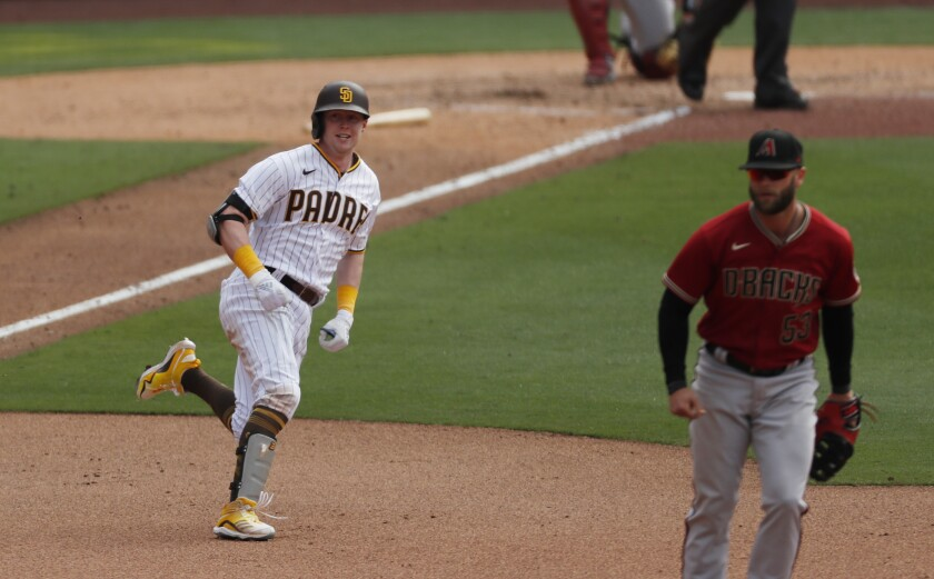 Jake Cronenworth delivers a clutch triple in Padres' opening-day win over Arizona on April 1 at Petco Park.