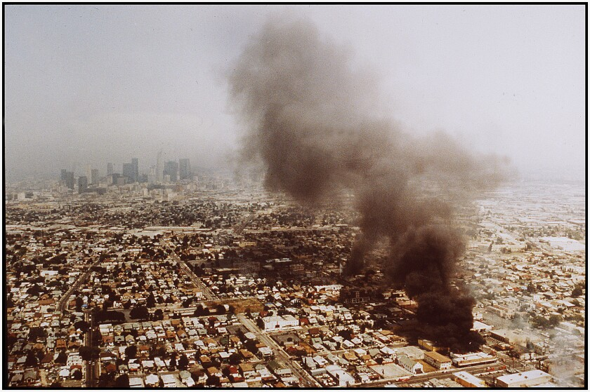 Fires burn out of control on the second day of rioting in Los Angeles following announcement of the Rodney King verdicts.