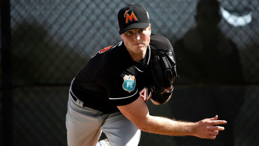 Miami Marlins pitcher Carter Capps throws a bullpen session during spring training baseball practice Monday, Feb. 22, 2016, in Jupiter, Fla.