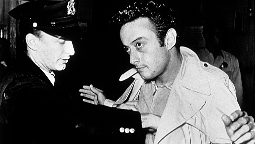 Lenny Bruce, right, during a run-in with police.