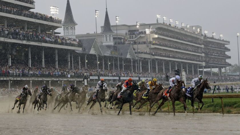 FILE - In this May 5, 2018, file photo, horses run during the 144th running of the Kentucky Derby ho