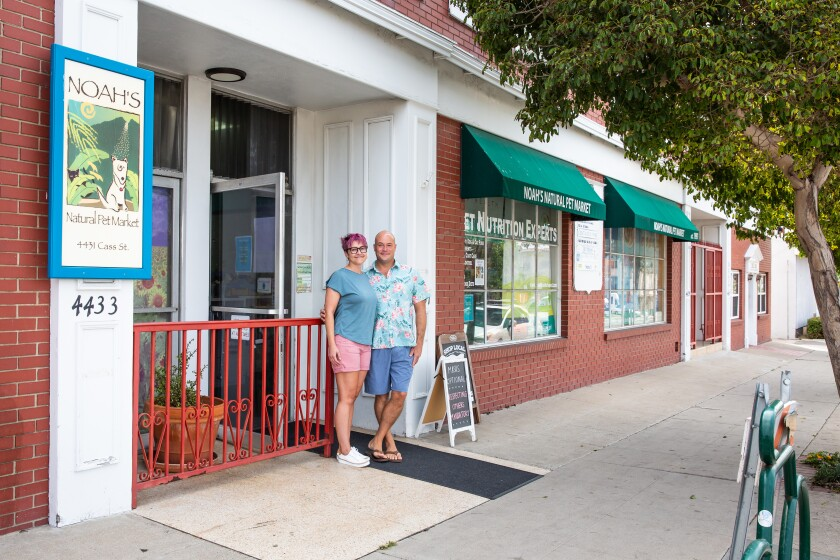 Alex and Andrew Dameron, owners of Noah's Natural Pet Market in Pacific Beach, are hopeful about new parking meters.