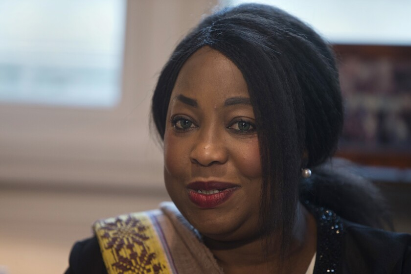 FILE - In this Monday, Feb. 5, 2018 file photo, FIFA Secretary General Fatma Samoura meets with Spain's Sports Minister Ínigo Mendez de Vigo in Madrid, Spain. FIFA's six months in control of African soccer appeared to end when Fatma Samoura's six-month spell in temporary charge of the continent's governing body was not extended on Sunday Feb. 2, 2020. (AP Photo/Paul White, File)