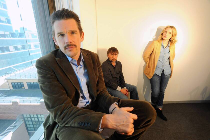 """Actor Ethan Hawke, front, director Richard Linklater and actress Julie Delpy, who collaborated on the film """"Before Midnight,"""" in offices at 42 West in Manhattan, NY."""