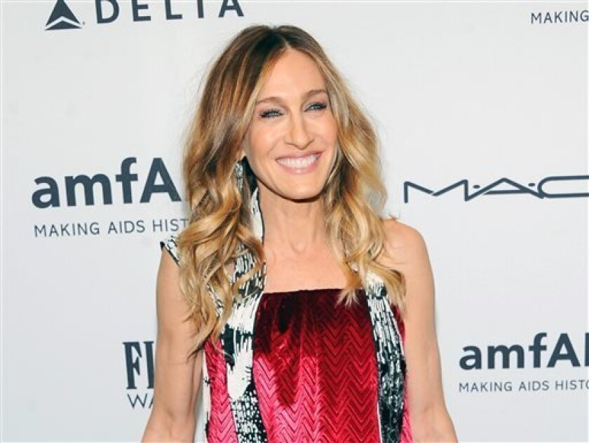 FILE - This Feb. 6, 2013 file photo shows actress Sarah Jessica Parker at amfAR's New York gala at Cipriani Wall Street in New York. Parker is donating a pair of Dolce Vita Pumps for a celebrity shoe auction benefitting LaGuardia High School of Music, Art and the Performing Arts. The special editio
