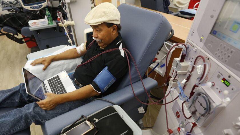 Adrian Perez undergoes dialysis at a DaVita Kidney Care clinic in Sacramento. If approved by voters in November, Proposition 8 would limit dialysis clinics' profits.