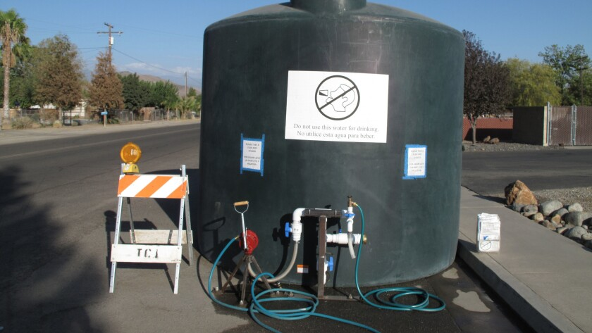 A 5,000-gallon water tank, which residents whose wells have run dry can draw water from, in East Porterville, Calif.