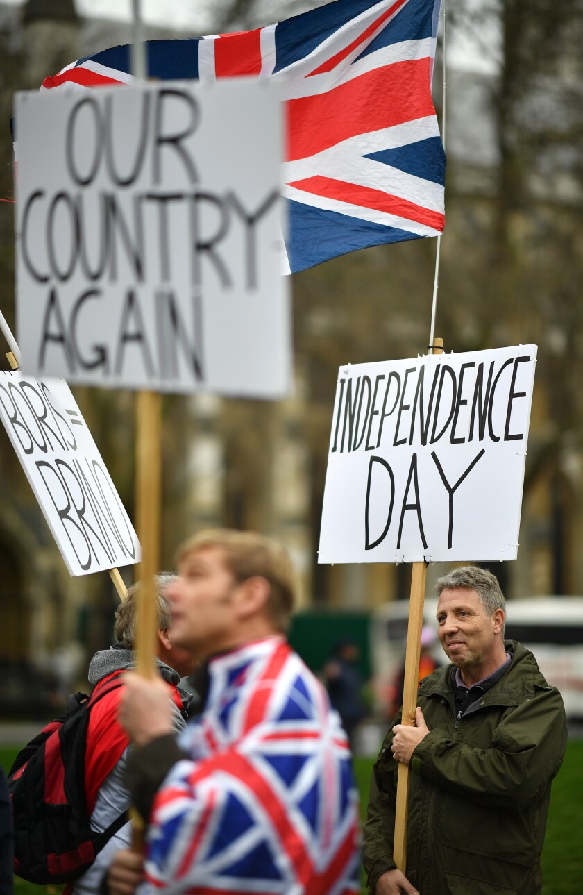 Brexit supporters march in Parliament Square in London.