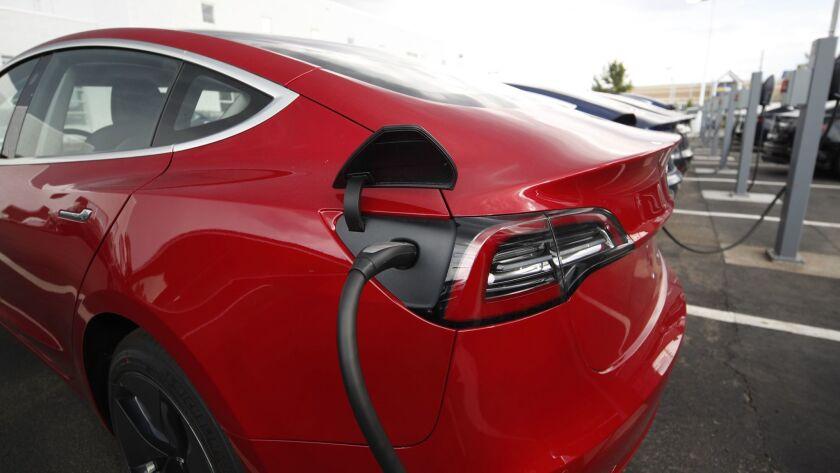 A Tesla Model 3 powers up in Littleton, Colo.
