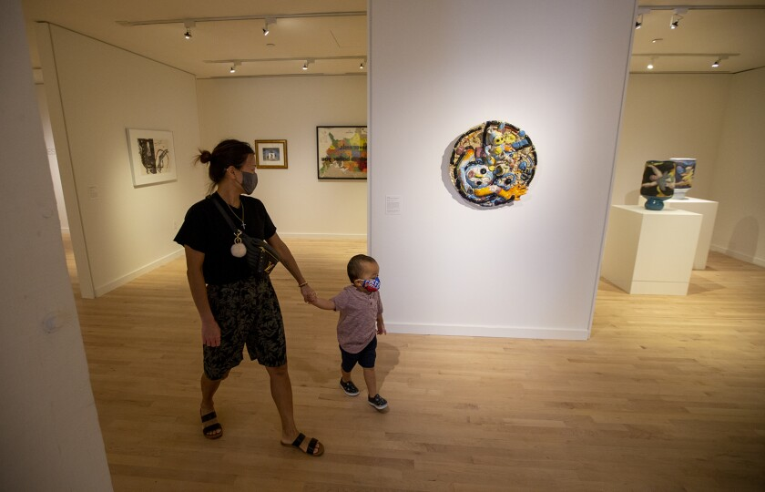 Jen Kim and her son Paxton, 3, look at art  at the Orange County Museum of Art.