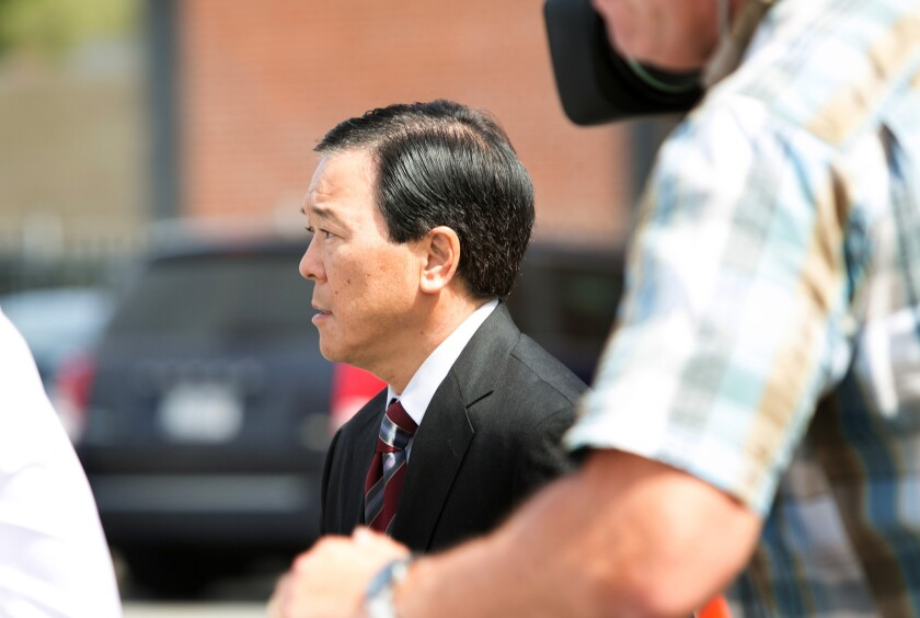 Former Los Angeles County Undersheriff Paul Tanaka leaves the downtown federal courthouse after a jury convicted him on conspiracy and obstruction of justice charges.