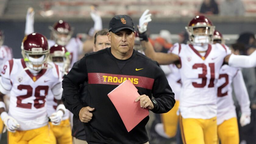 FILE - In this Nov. 3, 2018, file photo, Southern California head coach Clay Helton leads his team o