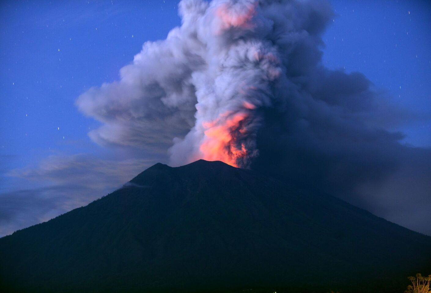 Mt. Agung erupts at night. Indonesian authorities extended the closure of the international airport on the resort island of Bali for a second day.