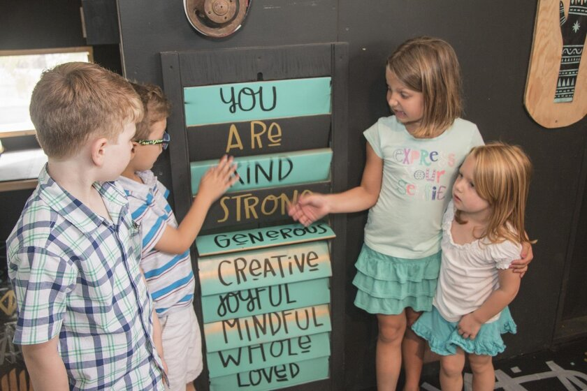 Declan, Donovan, Zoe and Quinn play with signs at  at The New Children's Museum in downtown San Diego.