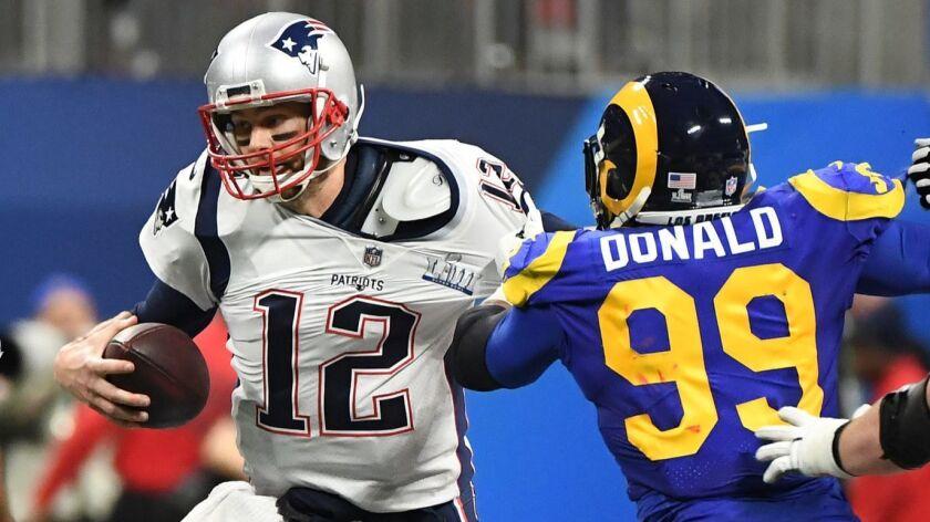 ATLANTA, GEORGIA, FEBRUARY 3, 2019 - Rams Aaron Donald hits Patriots quarterback Tom Brady during fi