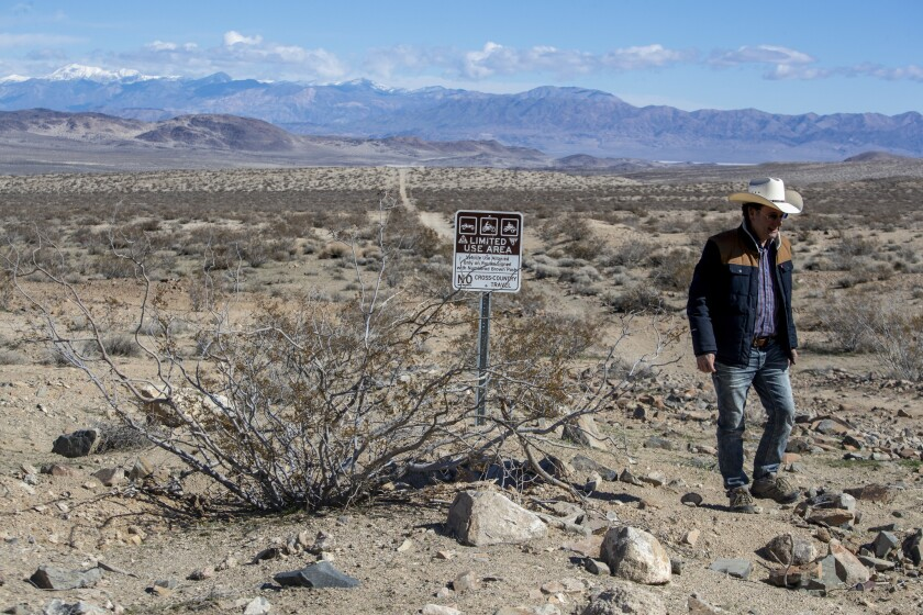 RIDGECREST, CALIF. -- MONDAY, FEBRUARY 18, 2019: Off-roading advocate Randy Banis looks over an expa
