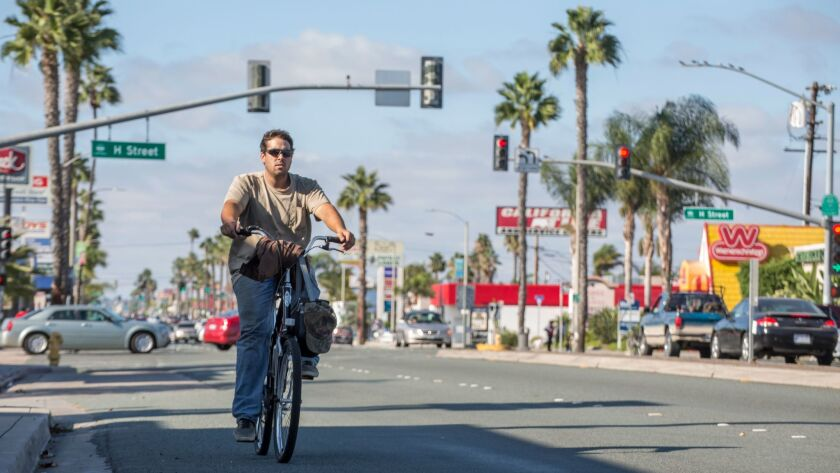 Bicyclist, Tim Dunkl, shares the road with motorists on Broadway in Chula Vista. October 15, 2015. P