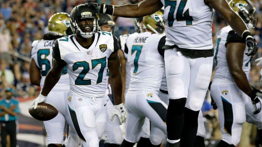 Jacksonville Jaguars running back Leonard Fournette (27) celebrates his touchdown against the New England Patriots in a preseason game Thursday.