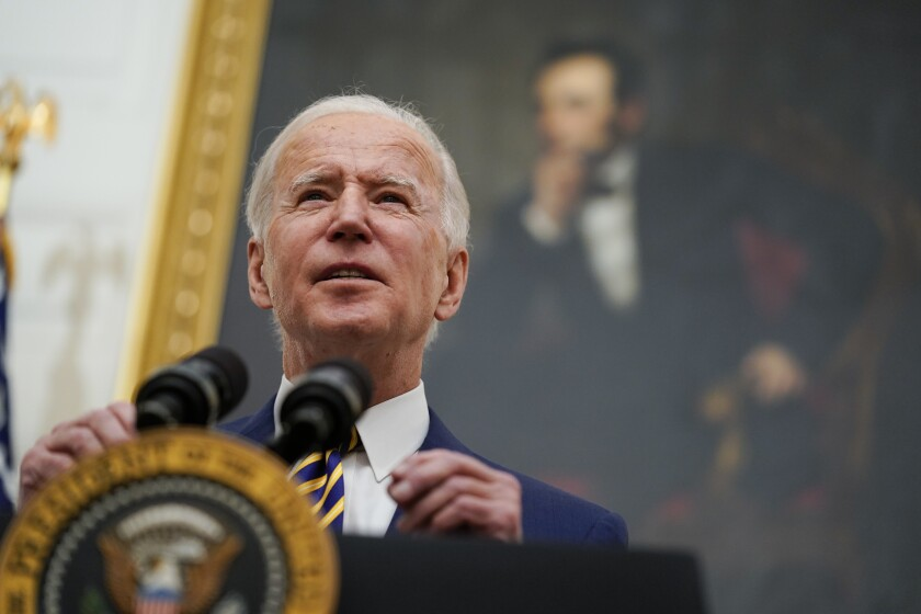 President Biden speaks in the State Dining Room of the White House.