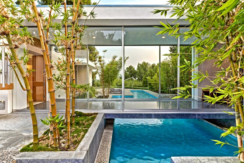 Home of the Week in Beverly Hills has a swimming pool walkway that bridges the main bedroom suite.