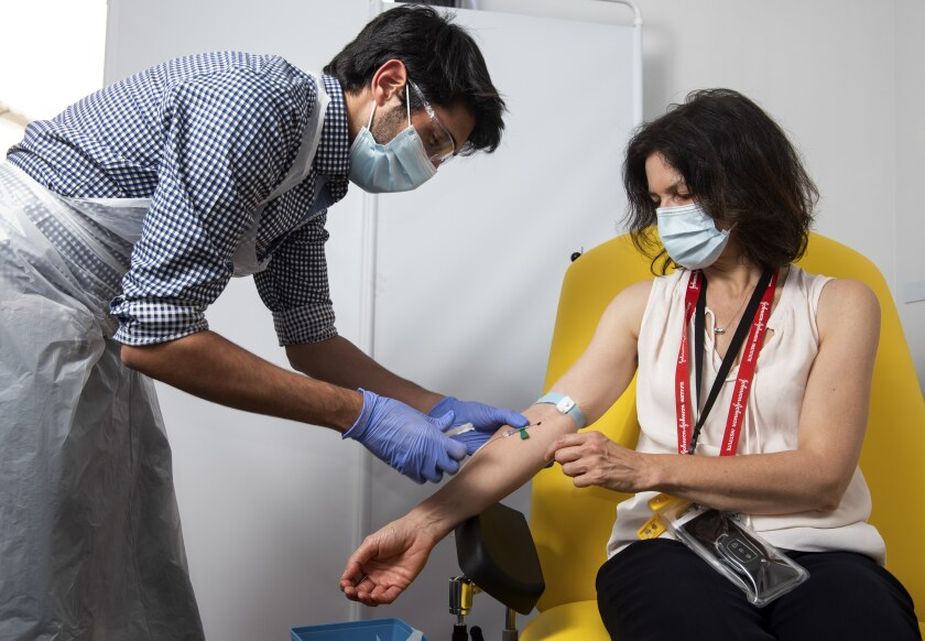 A doctor takes blood samples