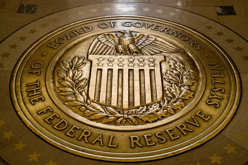 """FILE - This Feb. 5, 2018, file photo shows the seal of the Board of Governors of the United States Federal Reserve System at the Marriner S. Eccles Federal Reserve Board Building in Washington. Judy Shelton, President Donald Trump's nominee to the Federal Reserve touted her credentials in written testimony Thursday, Feb. 13, 2020, and said she would """"work collegially"""" if approved. She will likely face tough questioning by the Senate Banking Committee Thursday, which is considering her nomination. (AP Photo/Andrew Harnik, File)"""